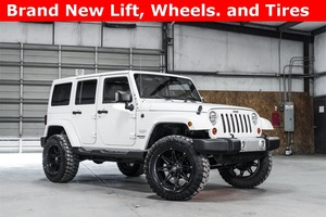 2013 Jeep Wrangler 4WD Unlimited Sahara LIFTED $35,988