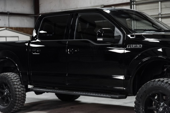 Lifted 2016 Ford F-150 4x4 SuperCrew Lariat  $51,488